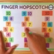 This FREE fine motor exercise - Finger Hopscotch is a no-prep, fun game to play! You can download the free printable at the bottom of the post.